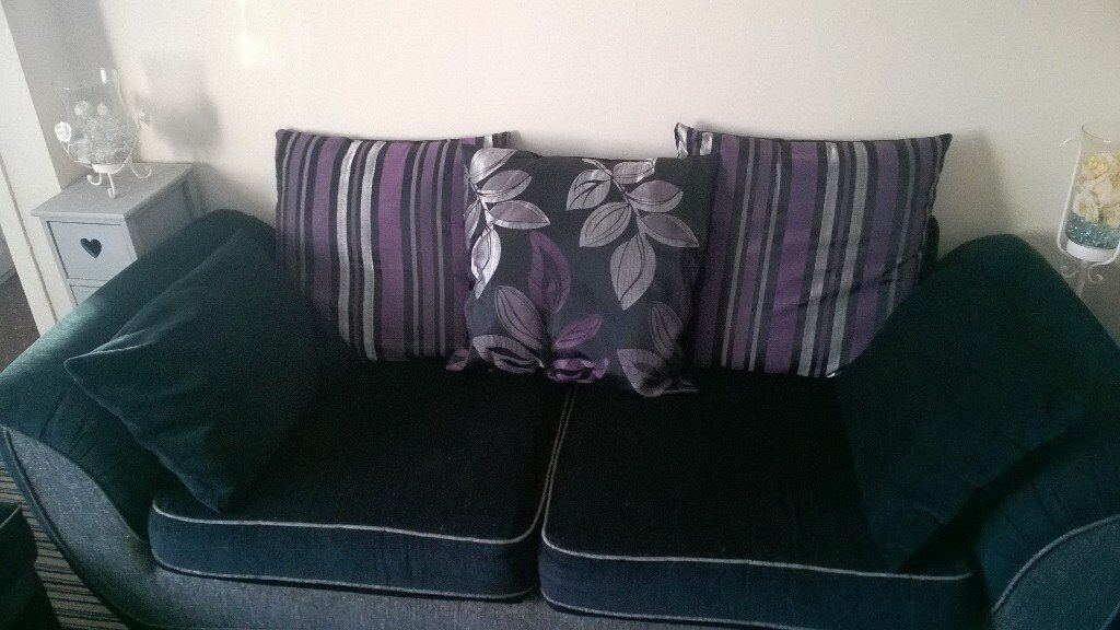3 Seater sofaFootstoolin Clock Face, MerseysideGumtree - Large 3 seater, scatter back settee in good condition. Comes with a matching pouffe/footstool. Delivery possible. Smoke and pet free home St.Helens 07712633957