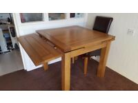 Extending Oak Dining Table & 4 Leather Chairs (Dark Brown).