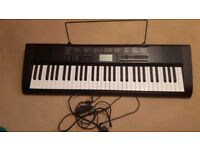 Casio Electric Keyboard.hardly used in good condition.
