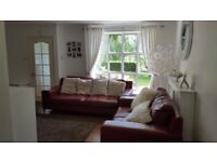 Red 3 Seater sofa and a 2 seater in perfect condition