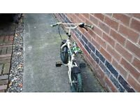 2 bikes, 1 bike is a small bmx style , second bike is a slighly larger bmx style