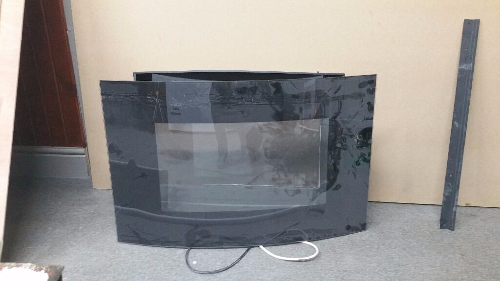 Decorative electric fireplacein Leith, EdinburghGumtree - used electric fireplace in good working order. Came with our flat but didnt work with our furniture. Attractive and pumps out the heat. Comes with remote. Curved Glass, wall mounted and decorative pebbles. Seems to be about 95 quid new. Looking for...