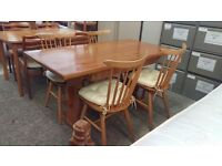 Pine dining table with 4 chairs and storage drawer