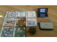 Black Nintendo DS lite bundle with Original Charger and 8games