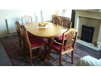 Large extendable pine dinning table and six chairs