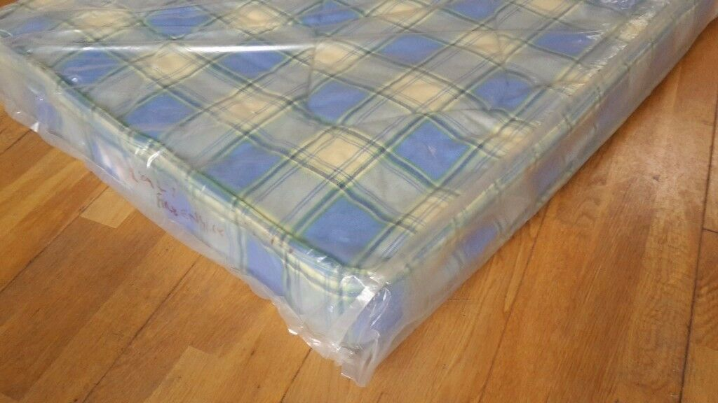 NEW, In bags. Small single size spring interior mattress. 80cm x 178cm matress