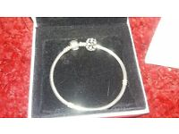 pandora bracelet worn once with gift bag and one charm