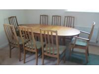 Wooden oval dining room table and 8 chairs