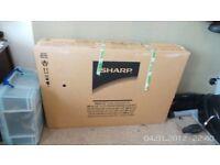 BRAND NEW SHARP TV STILL IN BOX