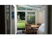 Lovely 1 bedroom ground floor flat with modern kitchen, private garden & atrium style dining room