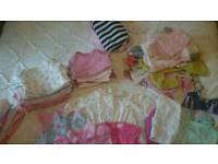 Big bundle of baby girls clothes.