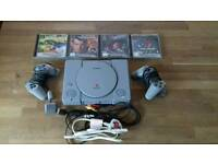 Playstation 1 w/ 4 games & 2 controllers