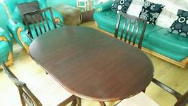 Mahogany dining room table. With 4chairs