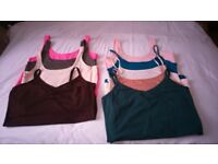9 Ladies sleeveless T Shirts in various colours