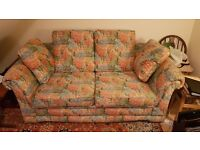 A two seater settee/sofa bed in good condition. Floral print