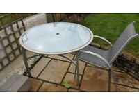 Garden table and four chairs for sale