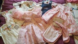Lots of baby clothes and other items