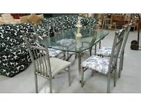 Solid glass dinning table and 6 chairs that have all just been recovered can deliver