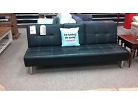 Lovely sofa bed black leather in great condition