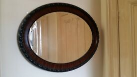 Beautiful flamed mahogany oval bevelled glass mirror