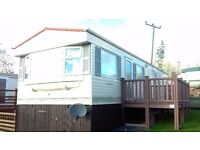 BK Caprice 35 x 12 2 Bed -complete with new deck and on a stunning plot. (offers are welcome)