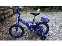"""12"""" 'Bumper' Bike in Blue with stabilsers and tool box for sale. £25 ono."""