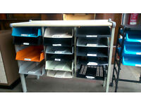 Tray storage unit