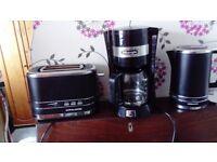 Black toaster, kettle, coffee machine