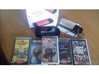Psp with 5gamea and box and info great condition