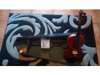 Violin/bow and wooden case. Not sure how old this is?