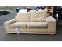 Cream large modern low backed 2 seater sofa