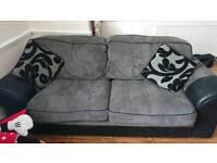 Two grey sofas