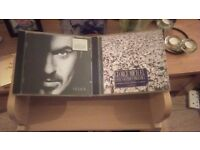 2 george micheal cd's + stand