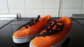 Heelys. One wheel. Orange. Size 3