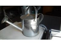 A lovely aluminium watering can in excellent condition