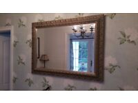 Large ornate wooden wall mirror.