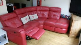 Real leather red corner sofa, electrical recliner to right side, good condition