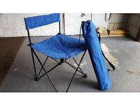 Two folding blue camping chairs
