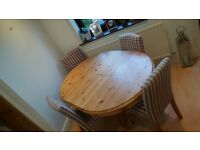 Solid pine extendable dining table and chairs