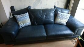 2x blue leather 3 seater sofas