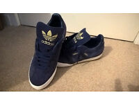 like new pair of size 10 small fitting adidas samba trainers dark blue and gold