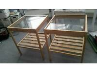 Twin glass top bedside tables