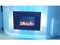 A MODERN WALL MOUNTED ELECTRIC FIRE