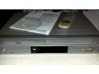 LG DV1010 DVD player/video cassette recorder c/w manual, remote, leads & a selection of videos!