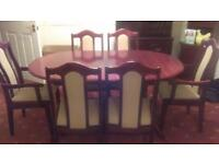 Oval extending mahogany table and four chairs and two carvers