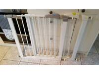 2 pressure fit safety gates and buggy board