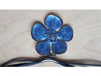 Necklace with large blue flower pendant