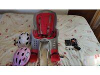Child bike seat + two children's bike helmets