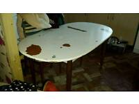 Wooden dining table - extends further