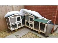 2 rabbit hutches joined together